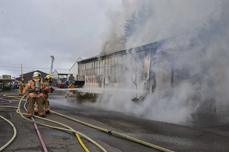 A multi-alarm fire, opposite, caused more than $200,000 at a facility owned by Rose Agri-seed on Barlow Road just outside Canby