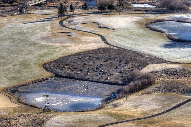 by: KEVIN SPERL - Pond number 10 at Meadow Lakes Golf Course was partially filled in to get rid of an ongoing sludge problem that produced unpleasant smells for golfers and nearby residents.