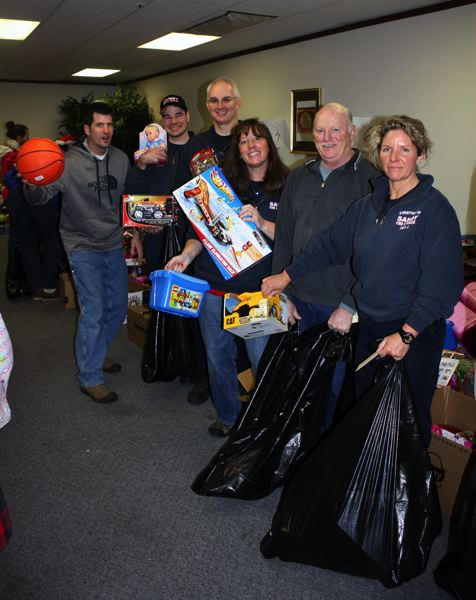 by: POST PHOTO: KYLIE WRAY - Sandy Fire helped at Fridays event. Karl Lange, Michael Baker, Captain Scott Howland, Nannette Howland, Lt. Ron Schneider and Laurie Smallwood pose with toys they picked out for children.