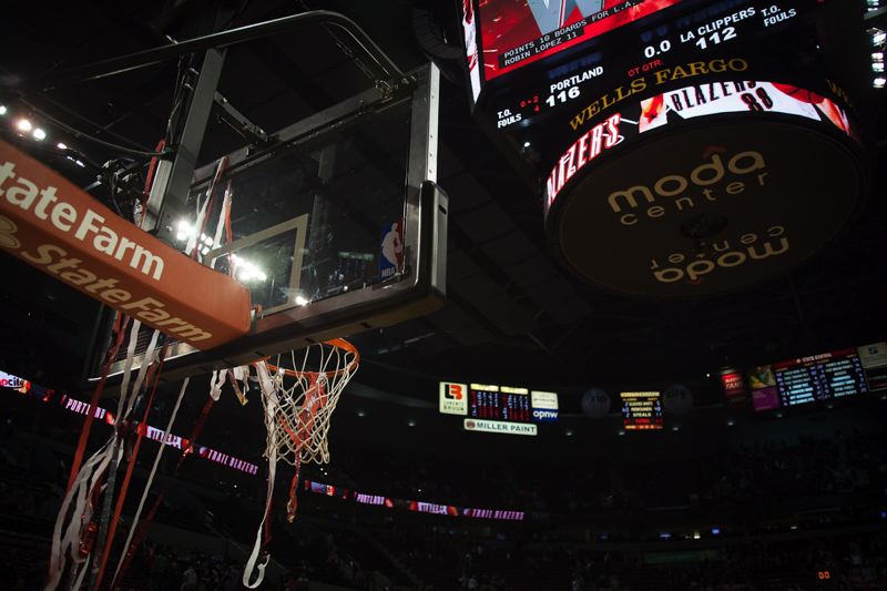 by: TRIBUNE PHOTO: MEG WILLIAMS - The scoreboard tells the story after another close victory for the Trail Blazers, in overtime Thursday night at home against the Los Angeles Clippers.