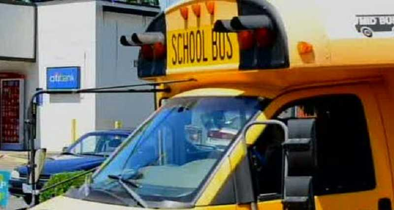 by: FILE PHOTO - A bus owned by the West Linn-Wilsonville School District and operated by First Student struck two pedestrians, killing one, on a street in Southwest Portland in July. Two children on the bus at the time were unharmed.