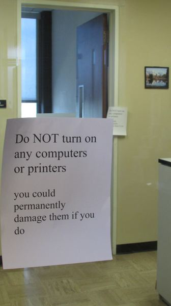 by: FILE PHOTO - Signs were posted inside the Columbia County Courthouse warning occupants not to use electronic equipment for fear that fire retardant powder lodged inside could damage or destroy it, as seen in this July 29 photograph.