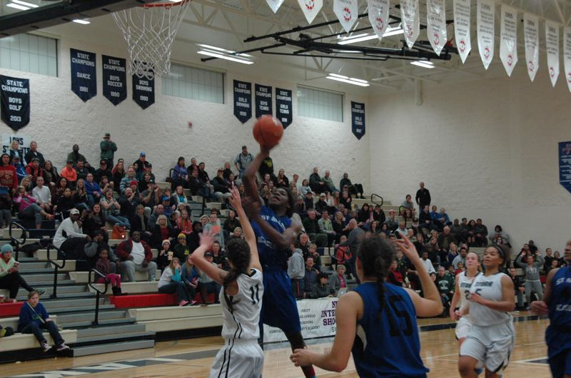by: COURTESY OF MIKE WEBER - Bendu Yeaney of St. Mary's Academy puts up the winning shot Sunday in the Blues' 56-54 semifinals victory over Skyview at the Nike Interstate Shootout in Lake Oswego High's gym.