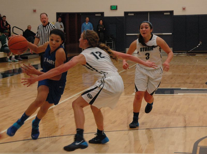 by: COURTESY OF MIKE WEBER - Martina McCowan of St. Mary's Academy starts a drive against Skyview.
