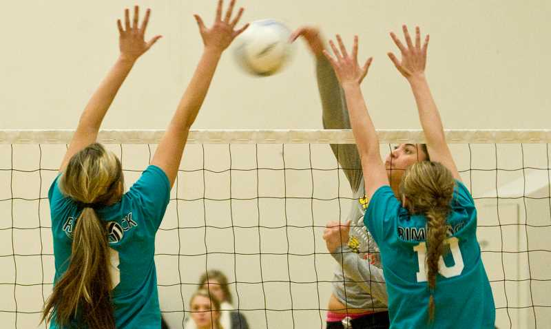 by: LON AUSTIN/CENTRAL OREGONIAN - Keani Passi rips a kill past Alexis Urbach and Karlee Hollis of the Rimrock Nationals team. Passi and the rest of her team won the Rimrock Alumni Tournament on Sunday defeating Rimrock Nationals in the Championship.