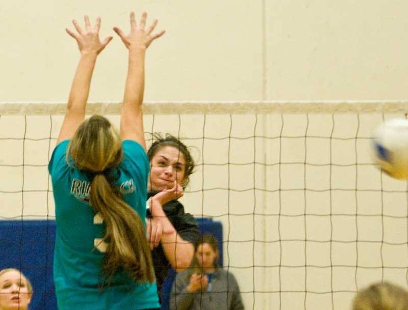 by: LON AUSTIN/CENTRAL OREGONIAN - Makayla Lindburg hits a kill for the alumni team during the championship match.
