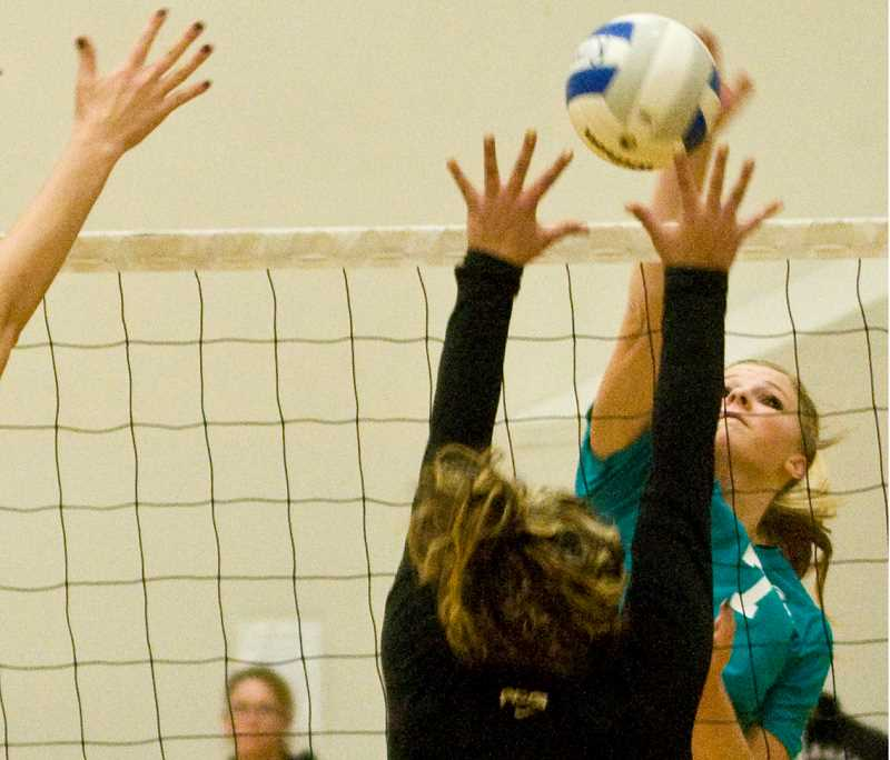 by: LON AUSTIN/CENTRAL OREGONIAN - Hannah Troutman goes up for a kill during the Rimrock Nationals championship match with Alumni Braiden. Alumni Braiden won the match 15-12, 15-10.