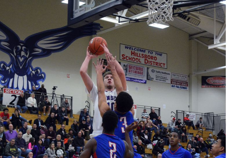 by: TIMES PHOTO: MATT SINGLEDECKER - Sunset post Tyler Gutierrez puts up a jumper against Churchill.