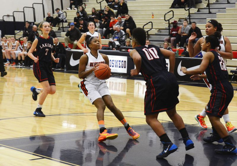 by: TIMES PHOTO: MATT SINGLEDECKER - Beaverton senior guard Danielle Hartzog pulls up in the lane for a jumper against Lake Oswego on Saturday.