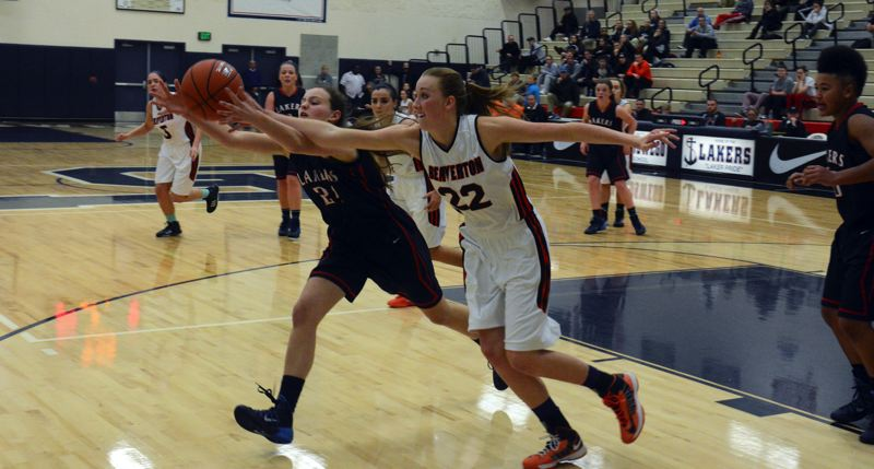 by: TIMES PHOTO: MATT SINGLEDECKER - Beaverton junior post Dagny McConnell scrambles after a loose ball in the second quarter of the Beavers' 54-33 win over Lake Oswego in the quarterfinals of the Interstate Shootout.