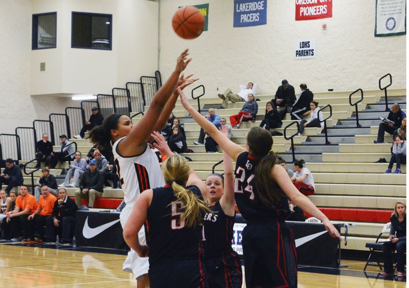 by: TIMES PHOTO: MATT SINGLEDECKER - Beaverton senior post Shaunta Jackson gets off a midrange jumper on Lake Oswego's defense in the first quarter of the Beavers' win.