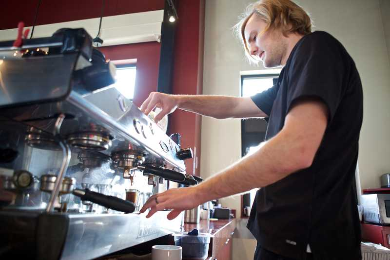 by: TIMES PHOTO: JAIME VALDEZ - John Stephenson,  manager of Metro Perc Coffee House & Drive-Thru, makes a cappuccino for a customer.