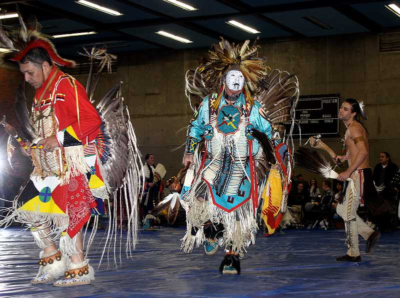 by: COURTESY PHOTO - Dancers from the grand entry at last years Portland Community College-sponsored powwow entertain attendees.