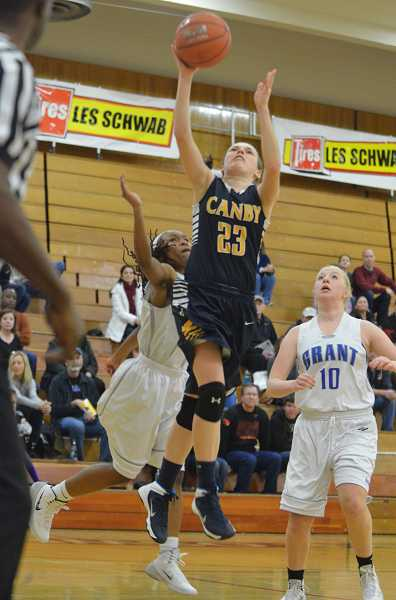 by: JEFF GOODMAN - Bailey Raines rises towards the rim for two of her 22 points Dec. 28 in the Canby girls basketball team's 74-48 rout of Portland-Grant at the Nike Interstate Shootout tournament at Lake Oswego High School.