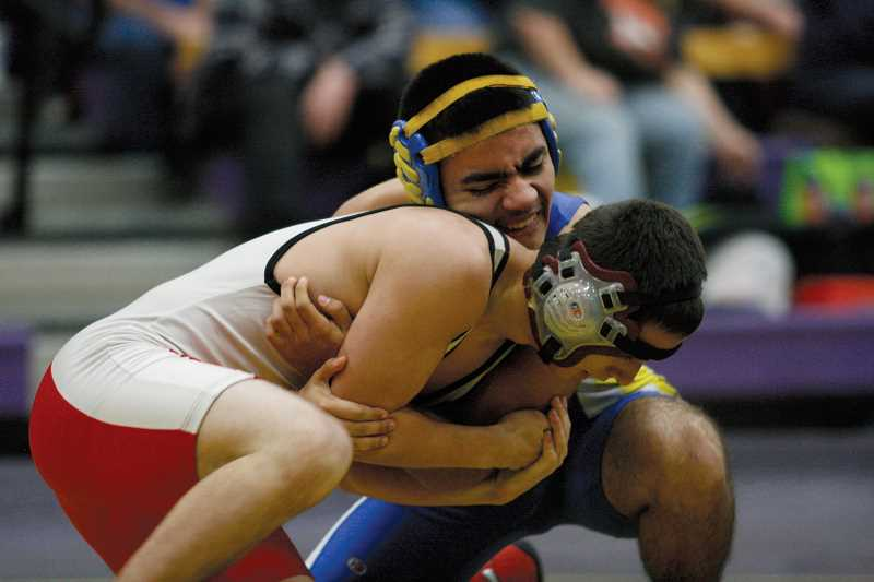 by: PHIL HAWKINS - Gervais' Darren DeLeon (facing front) scored a victory over Creswell's Skyler Tidwell in the opening round of the 126-pound bracket at the 2013 Eagle Classic hosted by Harrisburg High School Friday.