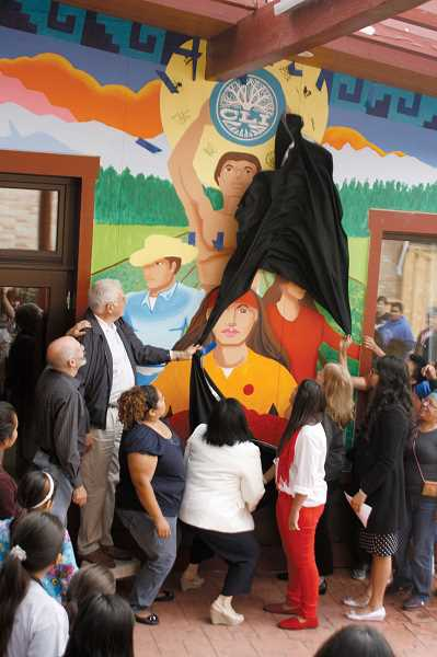 by: FILE PHOTO - Crowds gathered for the unveiling of Woodburn's first public mural at CAPACES Leadership Institute in September.