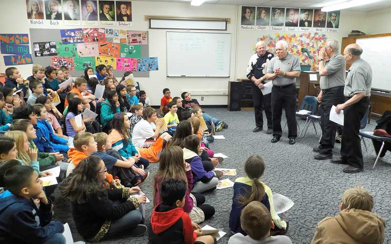 by: RAY HUGHEY - Members of the Oregon Trail Pitchpipers, above, stopped by Lee Elementary School in December to help students better understand music of America. The students got a chance to sing songs that are seldom heard today but are a part of this nation's heritage.