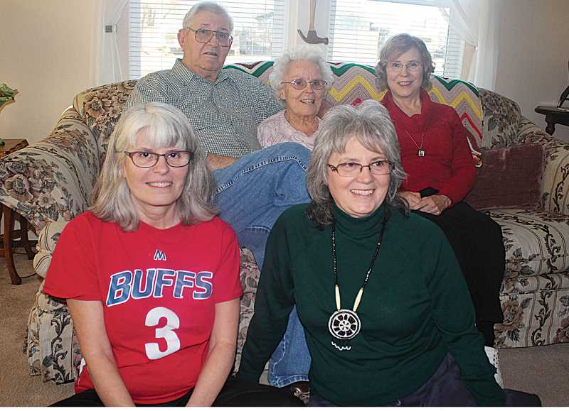 by: HOLLY M. GILL - Charles and Aline Roberts sit with daughters Becky Soules (front left), of Madras, Marylee Meliza, of Old Town, Idaho, and Charline Maynard (back right), of Milwaukie, on their 70th anniversary Dec. 20, 2013.