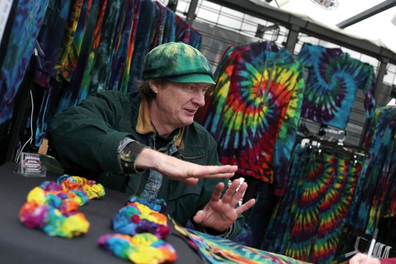 by: TRIBUNE PHOTO: JONATHAN HOUSE - Sam Bascom of the Stellar Spectrum sold $500 of tie-dyed clothing in the last few hours of business last year, but said business this Christmas Eve wasnt as strong.