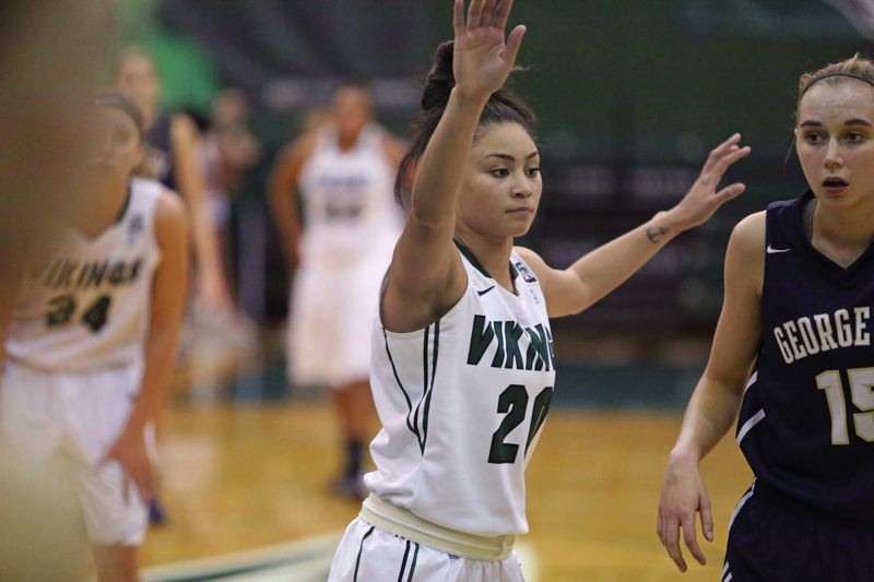 by: COURTESY OF PORTLAND STATE UNIVERSITY - Junior guard Lariel Powell (left), from the Bay Area, has come to love Portland and her role with the Portland State womens basketball team.