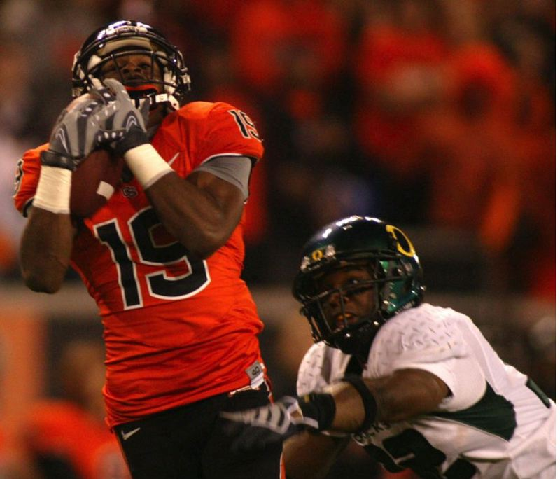 by: TRIBUNE FILE PHOTO: SAMMIE STROUGHTER - Sammie Stroughter of Oregon State makes a long catch that led to a touchdown in the 2008 Civil War at Reser Stadium.