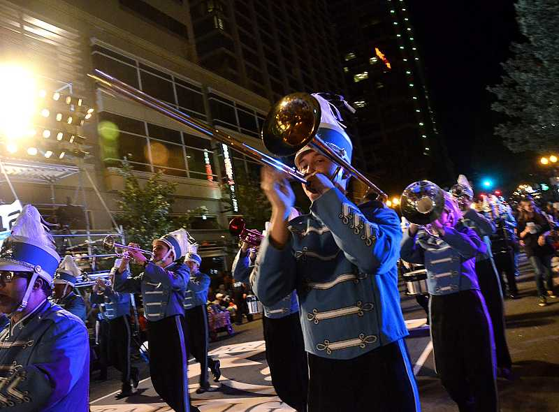 by: REVIEW PHOTO: VERN UYETAKE - The Lakeridge High School band earned accolades at the Starlight Parade.