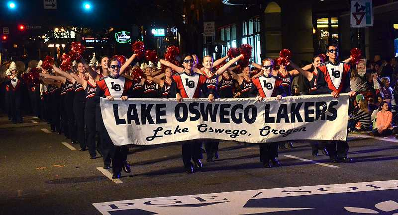 by: REVIEW PHOTO: VERN UYETAKE - The Lake Oswego High School band was honored at the Starlight Parade.