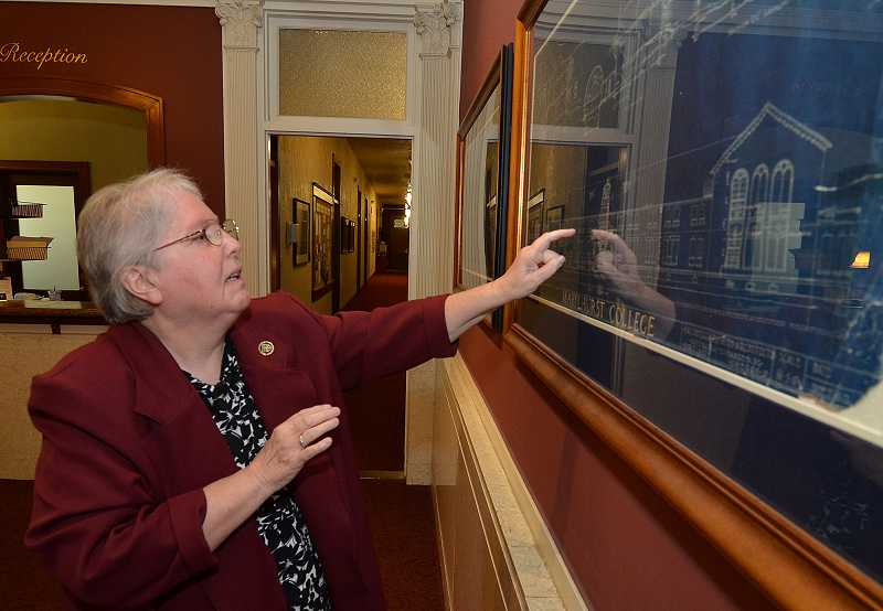 by: REVIEW PHOTO: VERN UYETAKE - Sister Carole Strawn discussed the history of the B.P. John Administration Building.