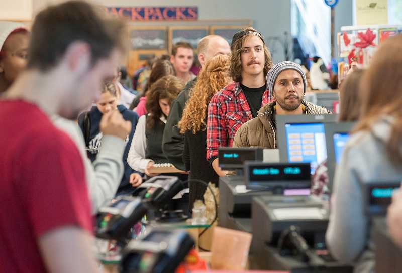 by: PAMPLIN MEDIA GROUP: JOSH KULLA - Many Portland Community College students at the Sylvania campus begin their first day of school in the book store.