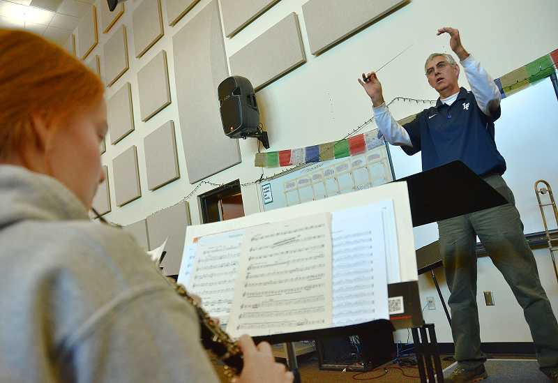 by:  REVIEW PHOTO: VERN UYETAKE - This was the last school year at Lake Oswego High School for band teacher Dave Matthys.