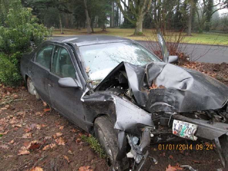 by: SUBMITTED PHOTO: OSP - Chael Jakob Lynch, 22, from Oregon City, was injured after crashing his Toyota Camry into trees lining the rest area entrance ramp next to the southbound lanes of Interstate 5.