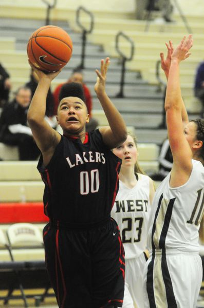by: MATTHEW SHERMAN - Lake Oswego's Morgan McKinney was one of her team's top scorers at the Nike Interstate Shootout.