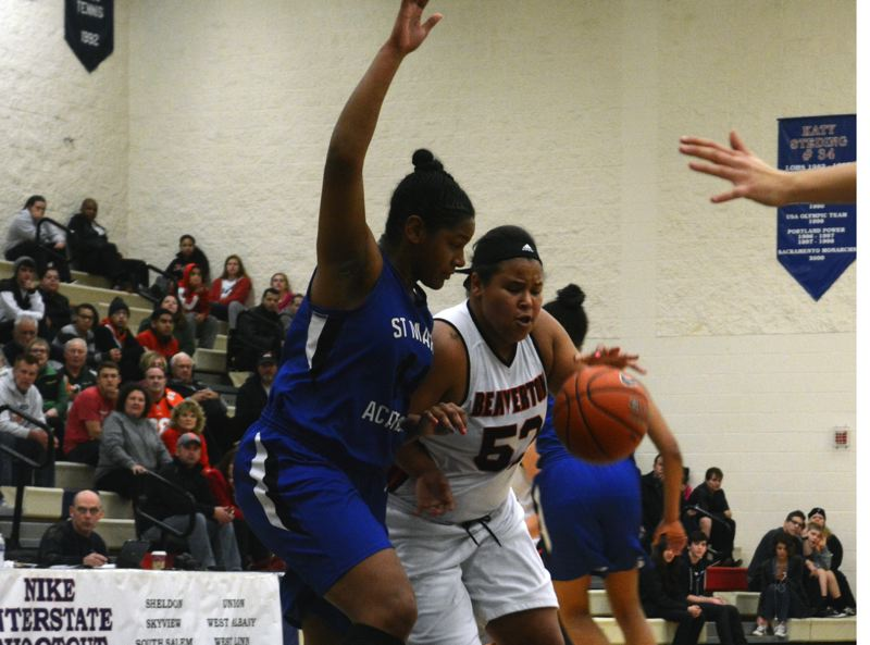by: TIMES PHOTO: MATT SINGLEDECKER - Beaverton senior post Shaunta Jackson makers her way into the lane against St. Mary's on Wednesday in the championship game of the Interstate Shootout.