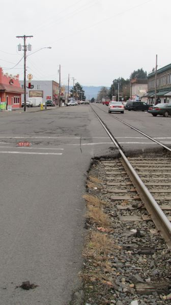 by: SPOTLIGHT PHOTO: MARK MILLER - The Portland and Western Railroad runs along much of A Street in downtown Rainier.