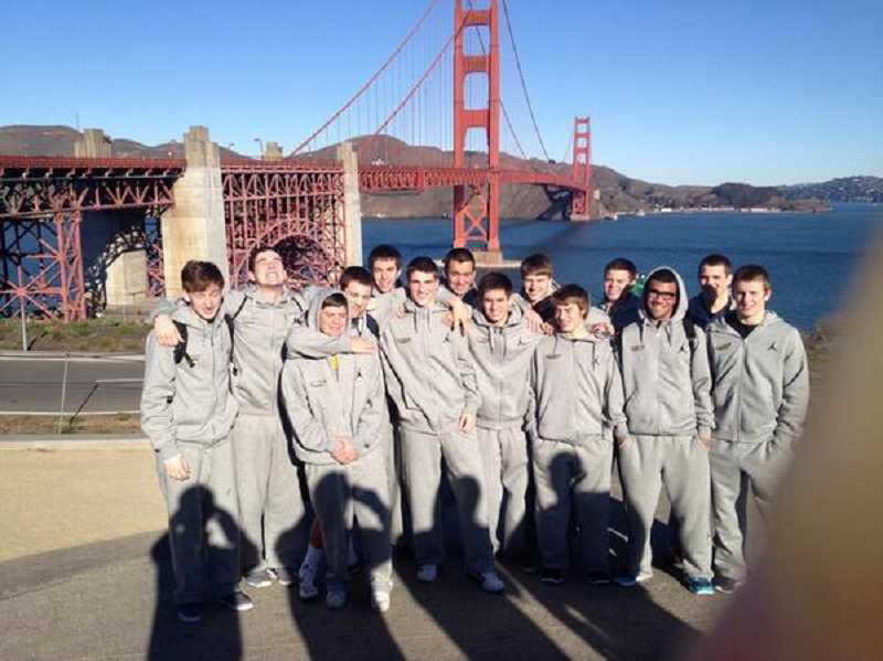 by: VIA TWITTER / @CANBYBBALL - Members of the Canby boys basketball team pose near the Golden Gate Bridge during their trip to the Bay Area. The Cougars won one of their three games at a San Francisco tournament.