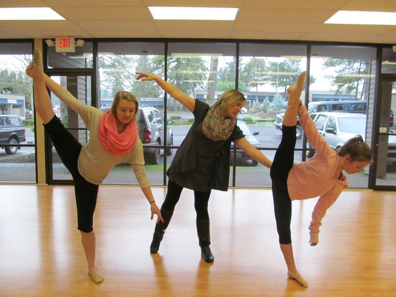 by: PHOTO BY ELLEN SPITALERI - Sherry Summerville, center, works with two of her regular dance students, including her daughter, Sydney, 17, left, and Hailey Dickerson, 11.