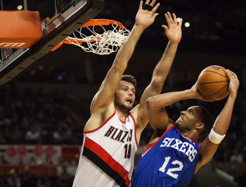 Backup Blazers center Joel Freeland challenges Philadelphia's Evan Turner.