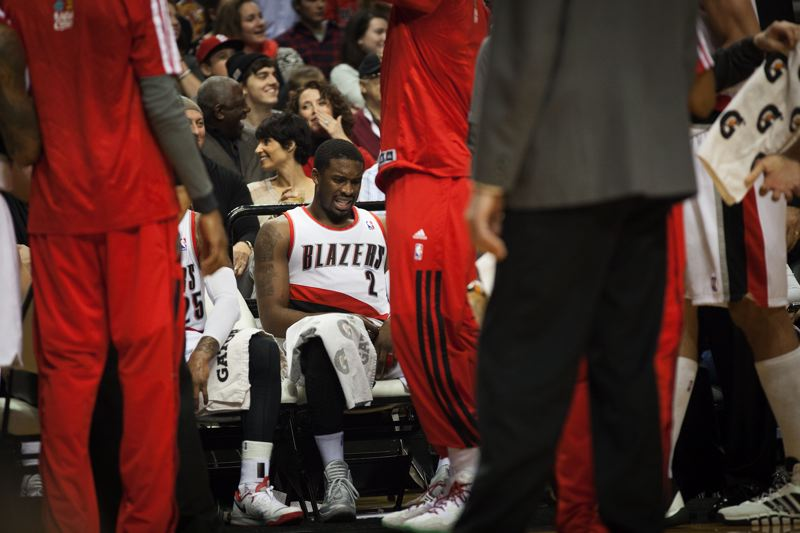 Blazers guard Wesley Matthews grimaces on the bench.