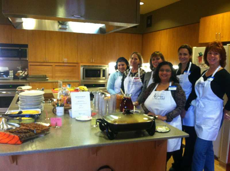 by: SUBMITTED PHOTO - Members of the Lake Oswego Womens Club became provisional chefs in training at the Ronald McDonald House recently. Pictured, from left, are Jane Luby, Karen Schneider, Jackie Medecki, Minita Feldsien, Karen Norgaard and Gaby Gardner, who   helped prepare egg casseroles, sausage, bacon, fruit salad, pecan waffles, banana caramel pancakes and pancakes with fresh blueberry compote.  As delicious as all that sounds, the real treat was watching the families thoroughly enjoy the heartfelt feast, said DeLoris Scherschlight, 2013 LOWC membership chair. The care, consideration and love that was baked into each dish (was the equivalent) of knowing that we helped families in their time of need. Ronald McDonald House Charities of Oregon provides a home away from home for families with seriously ill children.