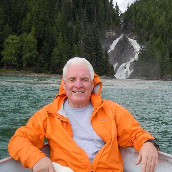 by: SUBMITTED PHOTO - John Baker, shown here relaxing at Quesnel Lake, decided that retirement was not for him. Now the new Lake Oswego resident is working on the biggest and most spectacular project in his busy, successful life.