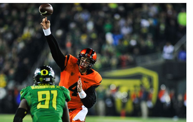 by: COURTESY OF JOHN LARIVIERE - Sean Mannion, passing for Oregon State in the 2013 Civil War game, says he wants to scramble for some first downs next season.