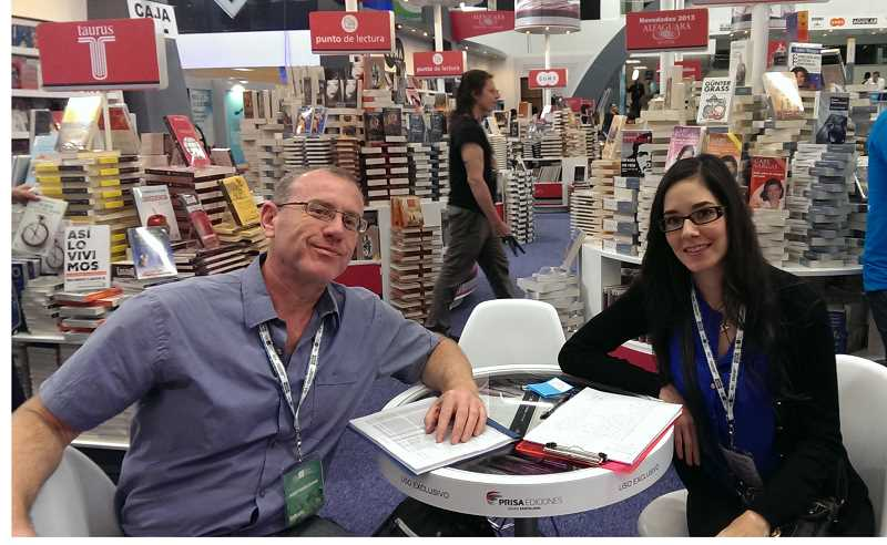 by: JOHN HUNTER - John Hunter, Woodburn's Public Library manager, sits with his assistant and translator to take a break from browsing through 300 vendors at Expo Guadalajara located in Mexico.