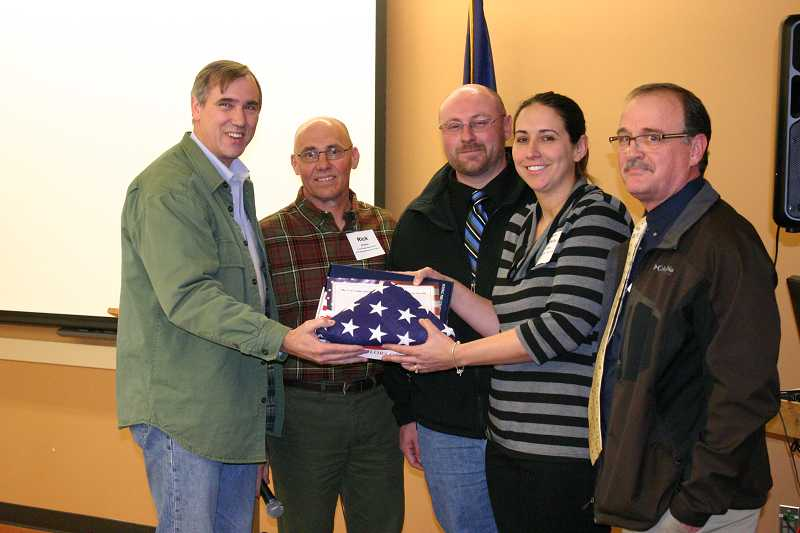 by: JASON CHANEY - At the beginning of his town hall, U.S. Senator Jeff Merkley presented an American flag flown over the Capitol building in honor of the Crook County High School Career Technical Education (CTE) program. Pictured left to right are Sen. Merkley, CCHS Natural Resources Instructor Rick Kramer, CCHS Agriculture Instructor Dan McNary, CCHS Principal Michelle Jonas, and Ray Hasart, CTE coordinator for the High Desert ESD.