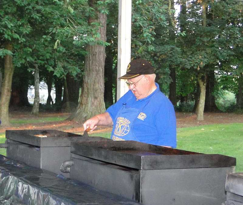 by: SUBMITTED - Warde Hershberger mans the griddle at a recent Fourth of July Chuckwagon Breakfast, put on by French Prairie Kiwanis, of which he's been a member for 37 years.