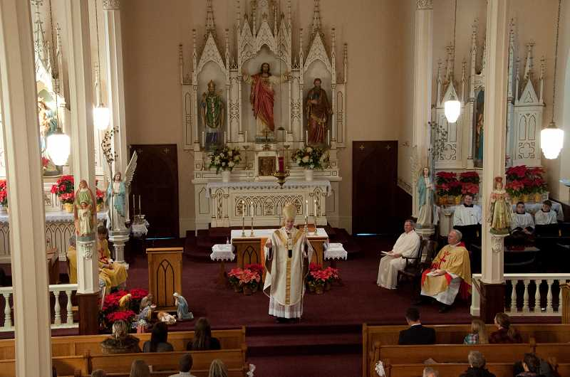 by: KAY SCHACHER - Archbishop Alexander Sample presides over Mass at St. Paul Catholic Church on Sunday as it commemorates its 175th anniversary.