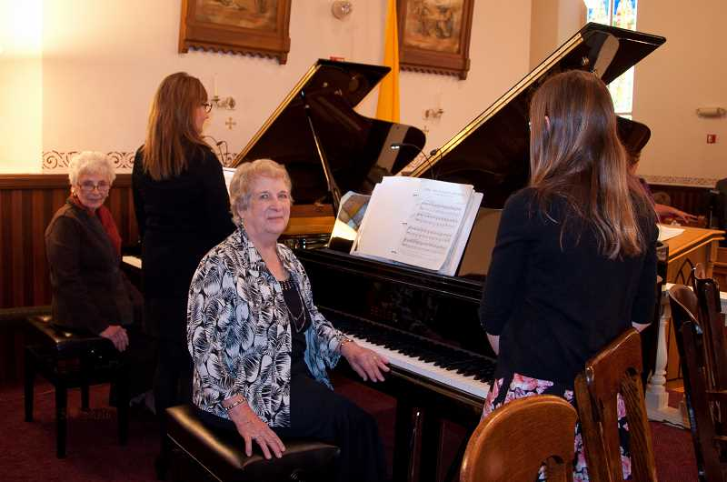 by: KAY SCHACHER - Maxine Ernst Brassel and Claudia Ernst Smith played dual grand pianos as part of a concert celebrating the 175th anniversary of St. Paul Catholic Church.
