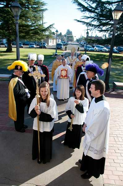 by: KAY SCHACHER - The procession organizes outside St. Paul Catholic Church before Mass.