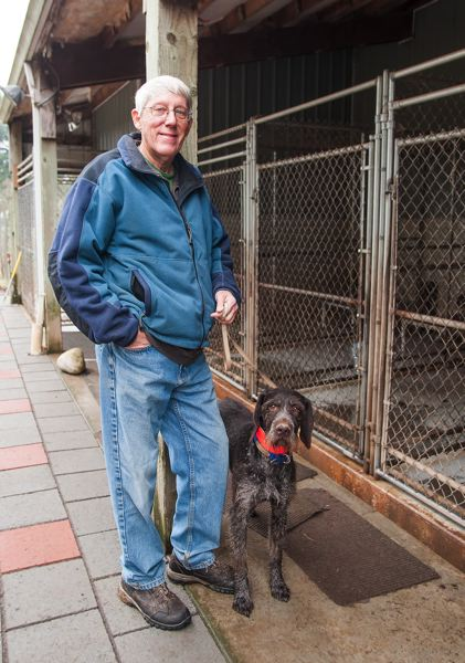 by: SPOKESMAN PHOTO: JOSH KULLA - Dr. Ray Calkins recently earned a lifetime achievement award from the American Kennel Club for his work with German wirehaired pointers. He currently has five such dogs living in this kennel, which features heated beds among other amenities.