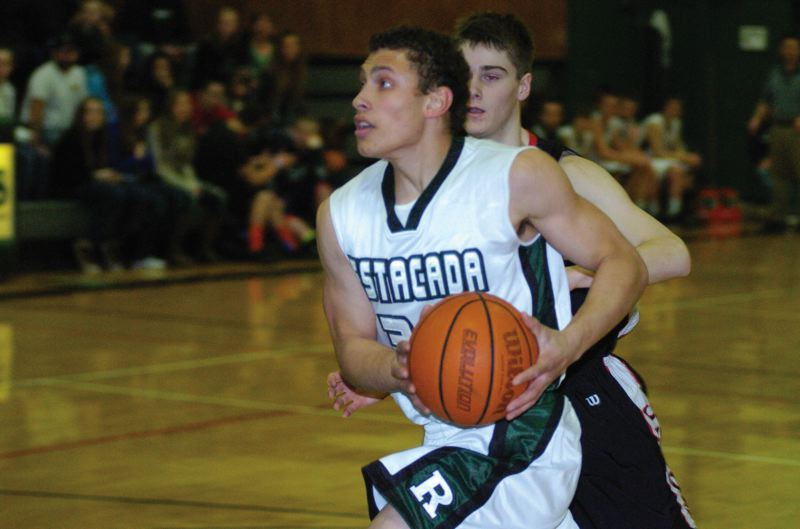 by: ESTACADA NEWS: PARKER LEE - Estacadas Alec Barstad drives to the basket during Mondays 78-46 win over Corbett.