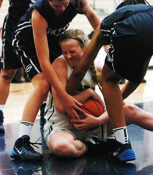 by: DAN BROOD - FIRM GRIP -- Tigard High School junior Kaylie Boschma fights to keep the ball away from a pair of Skyview players in Friday's game at the Nike Interstate Shootout held at Lake Oswego High School.